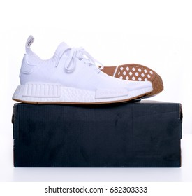 Kuala Lumpur, Malaysia - July 23, 2017:  Picture of Adidas Original NMD R1 Gum Pack All White with box over white background.