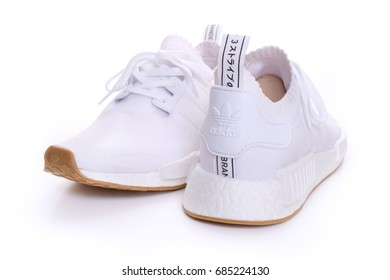 Kuala Lumpur, Malaysia - July 23, 2017: Picture of Adidas Original NMD R1 Gum Pack All White on white background