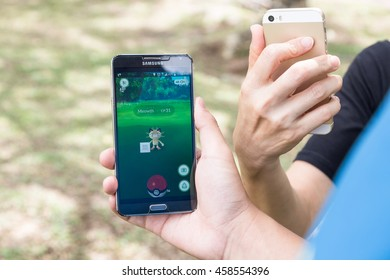 KUALA LUMPUR, MALAYSIA, JULY 24, 2016: An users play Pokemon Go, a free-to-play augmented reality mobile game developed by Niantic for iOS and Android devices.