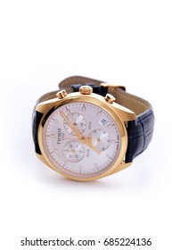 Kuala Lumpur, Malaysia - July 25, 2017: Picture of Tissot gold colour wrist watch with leather strap on white background