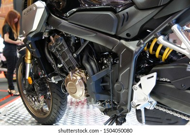 KUALA LUMPUR, MALAYSIA -JULY 27, 2019: Selective focused on a high performance motorcycle engine. The engine is installed on a designed motorcycle chassis.