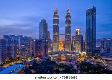 Kuala Lumpur, MALAYSIA - July 31, 2017: Petronas Twin Towers (fondly known as KLCC) and the surrounding buildings at sunset seen from the Skybar at Traders Hotel.