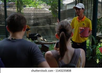 KUALA LUMPUR, MALAYSIA - JULY 5, 2018: Tourist enjoying hornbill feeding session at KL Birds Park in Kuala Lumpur.