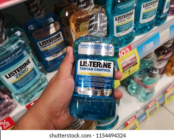 KUALA LUMPUR, MALAYSIA - JULY 7, 2018 : Man hand hold Listerine product displayed at supermarket.Listerine is an American brand of antiseptic mouthwash product, founded in 1879 in St.Louis,Missouri.