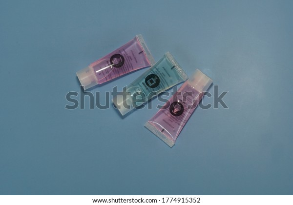 Kuala Lumpur, Malaysia- July 8, 2020; hotel shampoo isolated on blue background