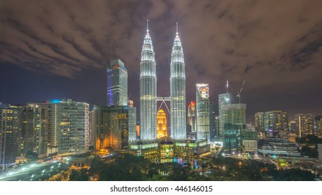 Kuala Lumpur, Malaysia - Jun 21, 2016: Night sky over Kuala Lumpur skyline surrounding Petronas Twin Towers. It is a famous and one of the biggest shopping mall and outdoor park in Kuala Lumpur.