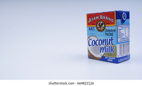 KUALA LUMPUR, MALAYSIA -JUN 21, 2017: Coconut milk of Ayam Brand non dairy on white background with copy space. Selective focus.