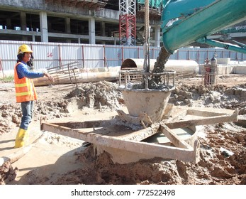 KUALA LUMPUR, MALAYSIA -JUNE 01, 2015: Bore pile concreting work at construction site. Wet concrete pour or pump from the concrete lorry into the bore pile casing.