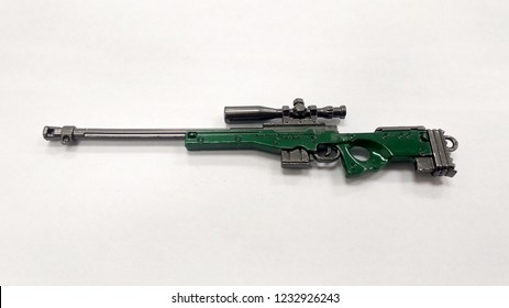 KUALA LUMPUR, MALAYSIA -JUNE 09, 2018: A miniature model of military sniper automatic gun in small-scale isolated on white background. Sale as a collector item for military gear collector and hobbyist