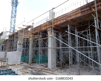 KUALA LUMPUR, MALAYSIA -JUNE 1, 2018: Reinforcement concrete column as part of building structure at the construction site. Reinforcement bar on top of column ready for next stage of construction