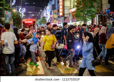 KUALA LUMPUR, MALAYSIA - JUNE 10, 2018. Thousand of local Muslim went out to look for items to celebrate Eid al-Fitr in Kuala Lumpur, Malaysia. Low light and high ISO photography.