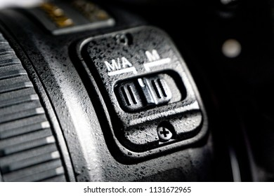 Kuala Lumpur, Malaysia - June 11, 2018 : Close-up macro shot of black camera body with auto and  manual focus button modes. Selective focus and crop fragment