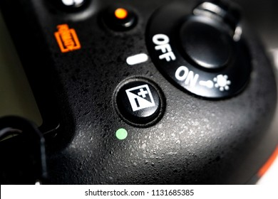 Kuala Lumpur, Malaysia - June 11, 2018 : Close-up macro shot of black camera body with exposure compensation buttons modes. Selective focus and crop fragment