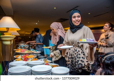 KUALA LUMPUR, MALAYSIA - JUNE 11, 2017: Muslim people who are fasting queue to take food for breaking fast in local hotel restaurant.