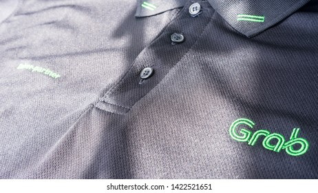 Kuala Lumpur, Malaysia - June 12,2019: Grab logo on its Driver-Partner official t-shirt. Grab is one of the biggest ehailing transportation network company provider in South-East Asia.