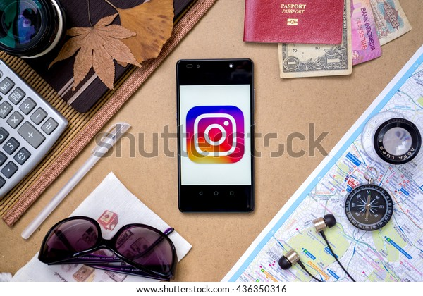 KUALA LUMPUR, MALAYSIA - JUNE 14TH, 2016: Modern lifestyle with smartphone to stay connected & browsing using favourite Apps. Post your stunning travel photo with Instagram Apps.