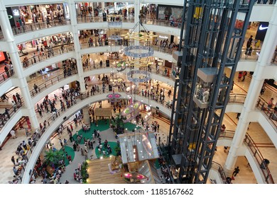 Kuala Lumpur, Malaysia - June 15, 2018: Shoppers visit Suria KLCC shopping mall. Opened in 1998 Suria KLCC houses 400 stores covering 1,500,000 sq m of retail space.