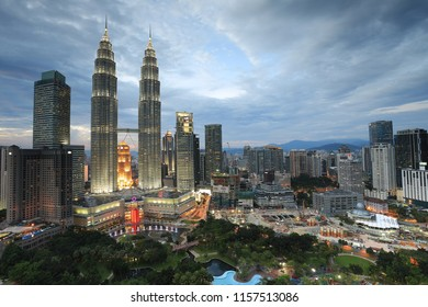 Kuala Lumpur, Malaysia - June 15th, 2018 : Majestic view of Petronas Twin Towers (KLCC) with beautiful sunset background. Vibrant colors. KLCC is the tallest building in Malaysia.