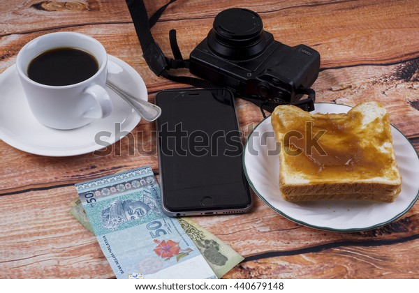 KUALA LUMPUR, MALAYSIA - JUNE 16, 2015 : Glasses, Iphone  and simple breakfast. Travel Concept.
