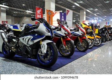 KUALA LUMPUR, MALAYSIA -JUNE 18, 2017: Big bike motorcycle in huge showroom. Some of the motorcycle still in wrapping plastic to protect its body from scratch.