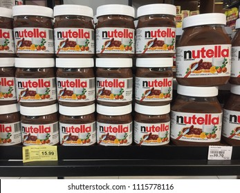 Kuala Lumpur, Malaysia - June 18, 2018: Nutella hazelnut spread jars on Supermarket shelves. Nutella is the brand name of a sweetened hazelnut cocoa spread. Manufactured by the Italian company Ferrero