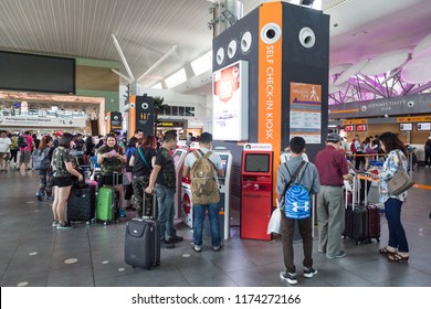 KUALA LUMPUR, MALAYSIA, JUNE 18, 2018: Passenger using convenient self check-in kiosk machine at KL International Airport facility to check in their flight.