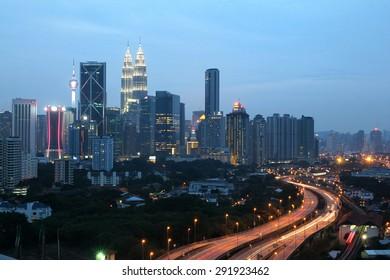 KUALA LUMPUR, MALAYSIA : JUNE 19, 2015 - Kuala Lumpur city skyline during twilight hours with lit up buildings