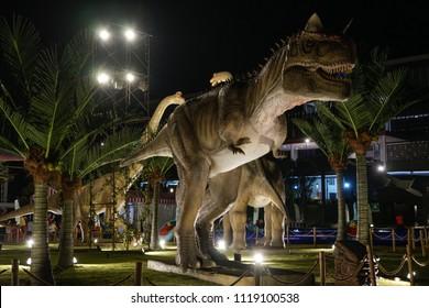 KUALA LUMPUR, MALAYSIA - JUNE 19TH, 2018 : Dinosaur Kingdom park at night located in Semenyih featuring variety types of Dinosaur like tyrannosaurus, stegosaurus, brachiosaurus and many more.