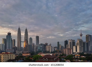 Kuala Lumpur, Malaysia – June 1st, 2017: View of Kuala Lumpur popular landmark with high rise building in urban city during sunrise. KLCC and KL Tower are most famous attractions in Kuala Lumpur.