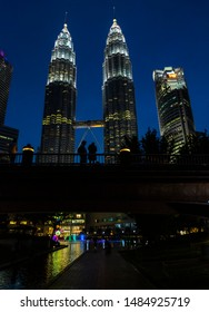 Kuala Lumpur, Malaysia - June 2018: Night cityscape and buildings in Kuala Lumpur downtown, Malaysia. Illuminated Bank and Petronas Towers Tower Buildings and KLCC center with fountains. Bright night.
