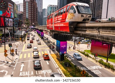 KUALA LUMPUR, MALAYSIA- JUNE, 2019: Monorail and busy street scene on Bukit Bintang, a vibrant area of city famous for its upmarket malls, bars and street life
