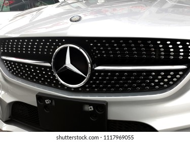 Kuala Lumpur, Malaysia - June 21, 2018 :  Mercedes Benz motor company logo on the front of a car. Mercedes-Benz is a German automobile manufacturer.