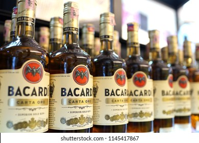 KUALA LUMPUR, MALAYSIA - JUNE 24, 2018: Rows of Bacardi Rum alcoholic beverages on store shelf in KLIA2 Airport. Barcardi is the largest privately held, family-owned spirits company in the world.