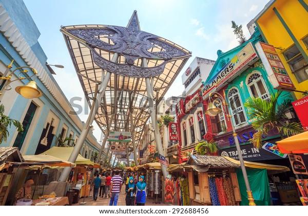 Kuala Lumpur, Malaysia - June 25: People walking and shopping around Kasturi Walk Central Market, Kuala Lumpur on June 25, 2015