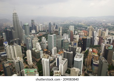 KUALA LUMPUR, MALAYSIA - June 29: View of the Petronas twin Towers, the tallest  buildings in the world in rainy weather from tv tower on June 29, 2014 in Kuala Lumpur.