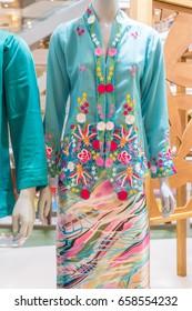 KUALA LUMPUR, MALAYSIA - JUNE 4, 2017:   Traditional Malay women outfit called Baju Kurung  on display at 1Utama Mall, Kuala Lumpur. The baju kurung; a knee-length blouse worn over a long skirt.