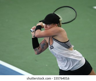 Kuala Lumpur, Malaysia, March 02 2013: American Bethanie Mattek-Sands returns a shot to Czech Karolina Pliskova during the final match of the WTA Malaysian Open tennis tournament