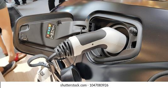 KUALA LUMPUR, MALAYSIA - MARCH 11, 2018: Close-up of charging cable from BMW i8 at roadshow in Kuala Lumpur, Malaysia.
