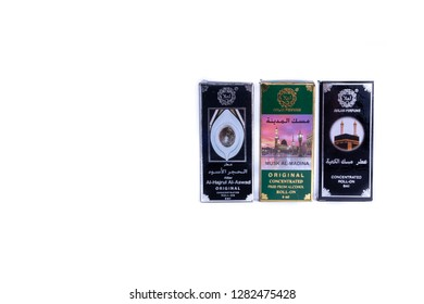 Kuala Lumpur, Malaysia - March 13, 2017 : Arabic perfume known as attar on white background with selective focus. It is an essential oil arabian attar in a mini bottle. Concentrated oil perfume