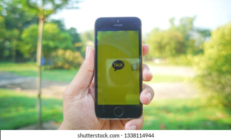 Kuala Lumpur, Malaysia - March 14: a photo of Kakao Talk apps on an iPhone with trees at the background. The apps becomes famous due to an artist controversy in South Korea