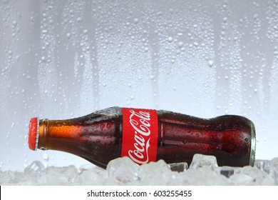 kuala lumpur Malaysia -March 14, 2017 Editorial photo of Classic Coca-Cola bottle in a freezer with ice cubes . Coca-Cola Company is the most popular market leader .