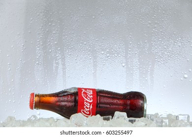 kuala lumpur Malaysia -March 14, 2017 Editorial photo of Classic Coca-Cola bottle in a freezer with ice cubes . Coca-Cola Company is the most popular market leader