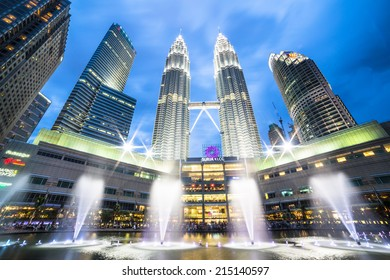 Kuala Lumpur, Malaysia - March 16 2014: The Petronas twin towers shine at night with fountain show in the Kuala Lumpur City Center (KLCC).