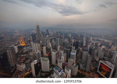 Kuala Lumpur, Malaysia - MARCH 18, 2016 : Sunset view with dramatic scene of illuminated urban city in Kuala Lumpur Malaysia. Kuala Lumpur is the capital of Malaysia. Image part of timelapse sequence