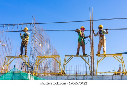 KUALA LUMPUR, MALAYSIA - MARCH 25, 2020: Construction workers work on high rise buildings at the construction site. Economy and development.