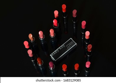 KUALA LUMPUR, MALAYSIA - March 26, 2020: The variation of Mary Kay red lipstick color over black back ground.