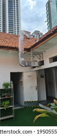 KUALA LUMPUR, MALAYSIA - MARCH 26, 2021 : Large exhaust hood for air blower in manufacturing food. Selective focus.
