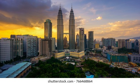 Kuala Lumpur, MALAYSIA - March 26, 2015: Petronas Twin Towers (fondly known as KLCC) and the surrounding buildings at sunset seen from the Skybar at Traders Hotel.