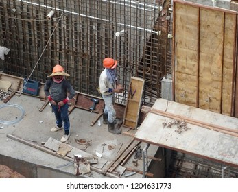 KUALA LUMPUR, MALAYSIA -MARCH 29 14, 2016: Construction workers fabricating steel reinforcement bar to form reinforcement concrete at the construction site.