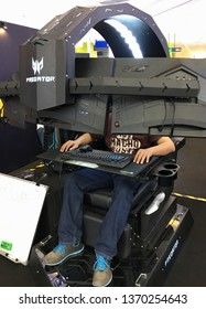 KUALA LUMPUR, MALAYSIA - MARCH 6, 2019: Unidentified people try a Predator Thronos gaming cabin in the Plaza low Yat mall. This Acer's new product is five feet tall and weighs over 485 pounds.